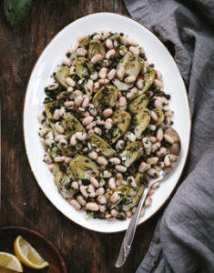 Warm Braised Baby Artichoke Salad with White Beans and Manchego